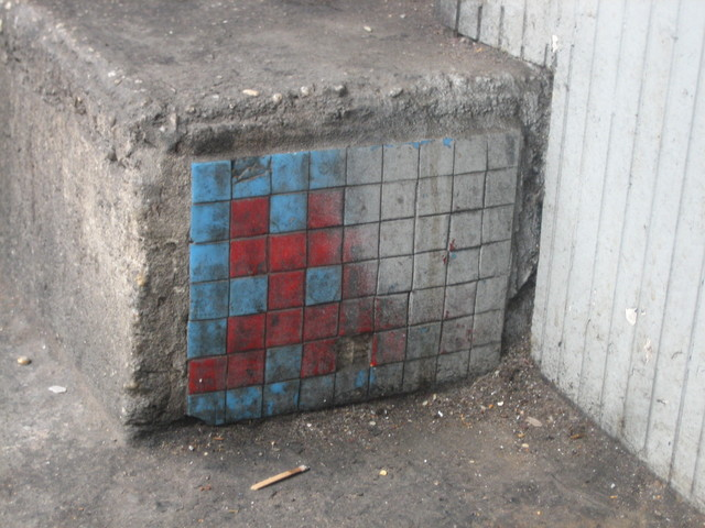 Space Invader in need of a wash on Canal St, North Side, Just West of Lafayette St on a step.