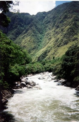 The bridge crosses over the Apurimac River at the bottom of the Sacred Valley
